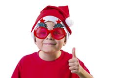 Funny boy Santa Claus in a hat and glasses. With a Christmas tree on a white background Stock Image