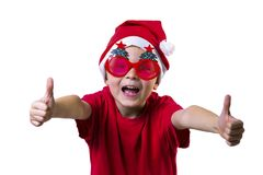 Funny boy Santa Claus in a hat and glasses. With a Christmas tree on a white background Royalty Free Stock Image