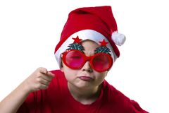 Funny boy Santa Claus in a hat and glasses. With a Christmas tree on a white background Royalty Free Stock Photos