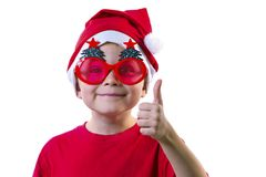 Funny boy Santa Claus in a hat and glasses. With a Christmas tree on a white background Royalty Free Stock Photography