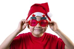 Funny boy Santa Claus in a hat and glasses. With a Christmas tree on a white background Stock Images