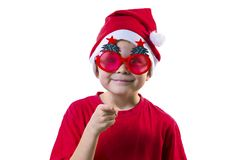Funny boy Santa Claus in a hat and glasses. With a Christmas tree on a white background Royalty Free Stock Photo
