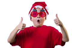 Funny boy Santa Claus in a hat and glasses. With a Christmas tree on a white background Royalty Free Stock Images