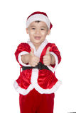 Funny boy in Santa hat showing thumbs up, on light snow backgro. Funny boy in Santa hat showing thumbs up, in light background. Christmas background concept stock image