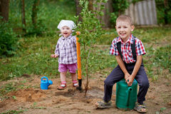 Funny boy with shovel in garden Royalty Free Stock Photography