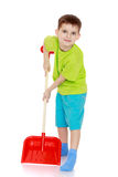 Funny boy with a shovel in his hands Stock Photography