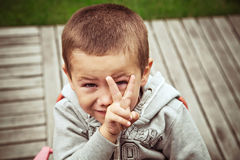 Funny boy showing gesture. Portrait of a funny boy showing gesture Royalty Free Stock Photos