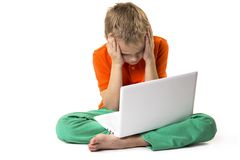Funny boy shows emotions and laptop Royalty Free Stock Photos
