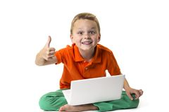 Funny boy shows emotions and laptop Stock Images