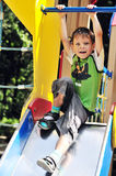 Funny boy on the slide Stock Photo