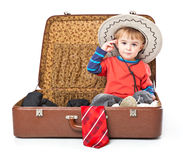 A funny boy with sombrero is in the suitcase Royalty Free Stock Image