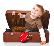 A funny boy with sombrero is in the suitcase Royalty Free Stock Photos
