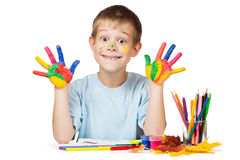 Funny boy with stained coloured hand. isolated Stock Photography
