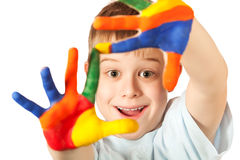 Funny kid with stained coloured hand Royalty Free Stock Images
