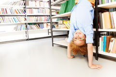 Funny boy standing on arms upside down Stock Photos