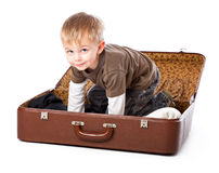 A funny boy in a suitcase Royalty Free Stock Photos