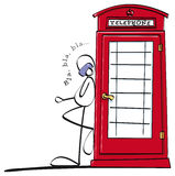 Funny boy talking on the phone. Man leaning against a phone booth Royalty Free Stock Photos