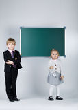 Funny boy teaching younger sister Stock Images