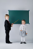 Funny boy teaching younger sister Stock Photo
