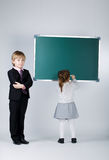 Funny boy teaching younger sister Stock Image