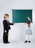 Funny boy teaching younger sister Royalty Free Stock Photos