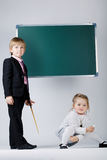 Funny boy teaching younger sister Stock Photography