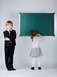Funny boy teaching younger sister Royalty Free Stock Image