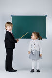 Funny boy teaching younger sister Royalty Free Stock Photo