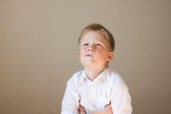 Funny boy thinking Stock Photos