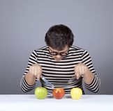 Funny boy try to eat apples. Royalty Free Stock Image
