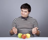 Funny boy try to eat apples. Stock Photography