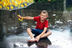 Gay boy with umbrella during a summer rain royalty free stock photography