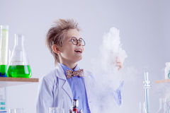 Funny boy watching reagent evaporation, close-up Stock Photos