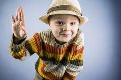 Funny boy waving hello Royalty Free Stock Photo