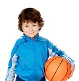 Funny boy holding a basketball royalty free stock image