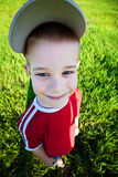 Funny boy wearing a cap with  visor. Funny boy wearing a cap Royalty Free Stock Photography