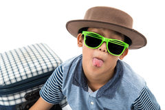 Funny boy wearing hat and green sun glasses. With suitcase  prepare for vacation on white Royalty Free Stock Photography