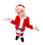 Funny boy wearing Santa Claus uniform. Wide angle funny boy wearing Santa Claus uniform Royalty Free Stock Images