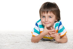 Funny boy on the white carpet Royalty Free Stock Images