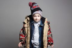 Funny Boy in winter outerwear royalty free stock photo