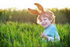 Funny boy of 3 years with Easter bunny ears, celebrating Easter Stock Images