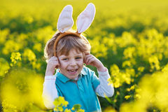 Funny boy of 3 years with Easter bunny ears, celebrating Easter Stock Image