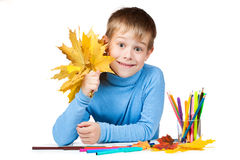 Funny boy with yellow leaves and pencils. isolated Royalty Free Stock Photography