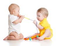 Funny boys with musical toys Stock Photos
