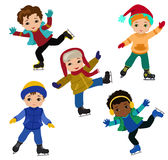 Funny boys in winter clothes ice skating isolated on white background . Stock Images