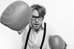 Funny Brave man. Nerd at boxer. Funny young man wearing red boxing gloves Stock Image