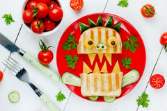 Funny breakfast for children - monster sandwich with bread, cucu Stock Images