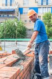 Funny bricklayer on house construction Royalty Free Stock Images