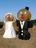 Funny bridal couple outdoors, made of hay bales, bavarian tradit Stock Images