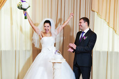 Funny bride and groom in delight Royalty Free Stock Photography